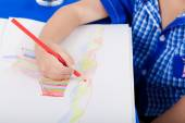 Hand of little child drawing — Stock Photo