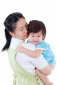 Asian mother carrying and soothe her daughter on white backgroun — Stock Photo