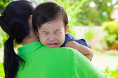 Mother carrying and comfort her daughter — Stock Photo