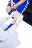 Youth asian sport boy in blue uniform. Knee joint pain. — Stock Photo