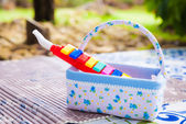 Plastic toy music pipe in basket prepared for kids — Photo