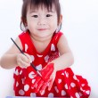 Asian girl painting her hand using drawing instruments, creativi — Stock Photo #70178237