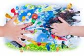 Closeup of little children hands doing finger painting with vari — Stockfoto