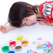 Girl lying on floor and hold paintbrush. On white. Studio shot — Stock Photo #80004804