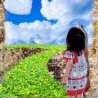 Girl draw nature with paintbrush on grunge wall background. — Stock Photo #83185890