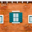 Window on the orange brick wall — Stock Photo #64244139