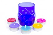Colorful glass with different candles on background. — Stock Photo