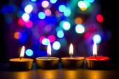 Burning tea candle in night — Stock Photo