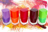 Bottles with spilled nail polish isolated on white background  — 图库照片