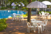White plastic garden furniture table and chairs summer evening - — Stockfoto