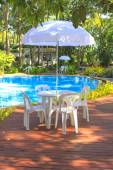 White plastic garden furniture table and chairs summer evening - — Stock Photo