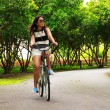 Stock Photo - Young woman cycling in park — Stock Photo #73520233