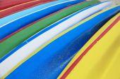 Stock Photo - Row of Kayaks beside the sea — Stock Photo