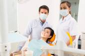 Dentist, assistant and smiling patient — Stock Photo