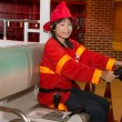Girl wearing firefighter uniform — Stock Photo #52172263