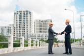 Architects shaking hands — Stock Photo
