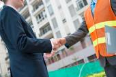 Businessman with construction worker — Stock Photo