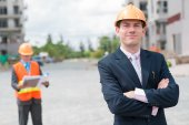Confident engineer with coworker — Stock Photo