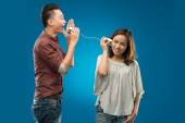 Vietnamese couple on a tin phone — Stock Photo