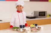 Happy little cook in the kitchen — Stock Photo