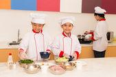 Vietnamese children cooking in the kitchen — Stock Photo