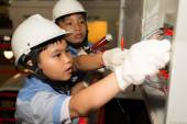Little electrical engineers working — Stock Photo