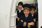 Capitan and cabin crew — Stock Photo