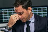 Tired stock market trader — Stock Photo