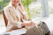 Female manager dialing number — Stock Photo