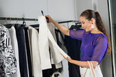 Woman choosing jacket — Stock Photo