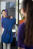Woman  trying on a dress — Stock Photo