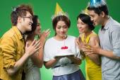 Birthday girl holding a cake — Stock Photo