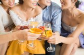 People clinking glasses and toasting — Stock Photo