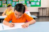 Asian boy drawing with pencil at the lesson — Stock Photo