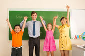 Teacher and pupils in the classroom — Foto Stock