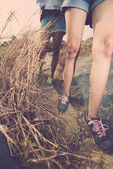Legs of hikers walking along narrow path — Stock Photo