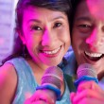 Senior Vietnamese couple with microphones — Stock Photo #52195559