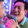 Aged Asian man singing a song in duet — Stock Photo #52195587
