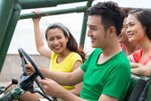 Vietnamese friends travelling by off-road vehicle — Stock Photo