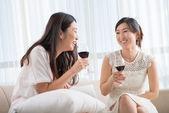 Korean female friends drinking wine — Stock Photo