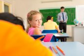 Lovely schoolgirl during the class — Stock Photo