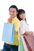 Vietnamese  couple holding shopping bags — Stock Photo