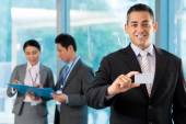 Businessman showing blank  visit card — Stock Photo