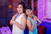 Elegant women in the karaoke bar — Stock Photo