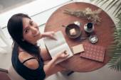 Woman  writing in the exercise book — Stock Photo