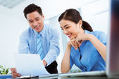Manager showing documents to coworker — Stock Photo