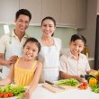 Asian family in kitchen — Stock Photo #54309893