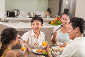 Asian people having fun at dinner — Stock Photo