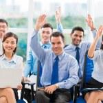 Business people raising hands — Stock Photo #54316267