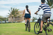 Couple riding on bicycles — Stock Photo